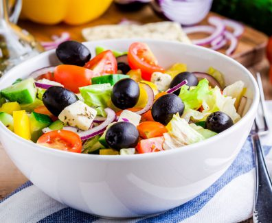 Greek salad of organic tomatoes, cucumber, red onion, olives and feta cheese